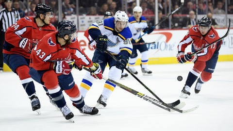 <p>               St. Louis Blues right wing Vladimir Tarasenko (91), of Russia, battles for the puck against Washington Capitals right wing Tom Wilson (43), defenseman John Carlson (74) and left wing Jakub Vrana (13) during the first period of an NHL hockey game, Monday, Jan. 14, 2019, in Washington. (AP Photo/Nick Wass)             </p>