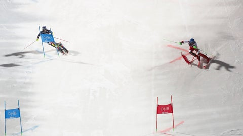 <p>               Marco Schwarz of Austria, right, competes alongside Britain's Dave Ryding on his way to win a World Cup parallel slalom, Holmenkollen in Oslo, Norway, Tuesday, Jan. 1, 2019. (Terje Bendiksby/NTB scanpix via AP)             </p>
