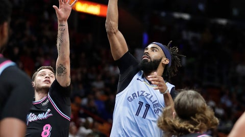 <p>               Memphis Grizzlies guard Mike Conley (11) shoots and scores against Miami Heat guard Tyler Johnson in the first half of an NBA basketball game on Saturday, Jan. 12, 2019, in Miami. (AP Photo/Brynn Anderson)             </p>