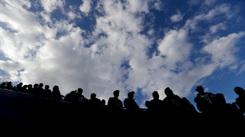 <p>               Fans watches during warm ups before an NFL divisional football playoff game between the Los Angeles Rams and the Dallas Cowboys Saturday, Jan. 12, 2019, in Los Angeles. (AP Photo/Jae C. Hong)             </p>