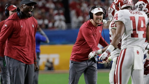 <p>               Oklahoma head coach Lincoln Riley, center, congratulates wide receiver Charleston Rambo (14) after Rambo scored a touchdowns, during the second half of the Orange Bowl NCAA college football game against Alabama, Saturday, Dec. 29, 2018, in Miami Gardens, Fla. (AP Photo/Lynne Sladky)             </p>