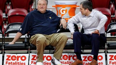 <p>               West Virginia head coach Bob Huggins, left, talks with Iowa State head coach Steve Prohm before an NCAA college basketball game, Wednesday, Jan. 30, 2019, in Ames, Iowa. (AP Photo/Charlie Neibergall)             </p>