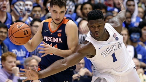 <p>               Duke's Zion Williamson (1) tries to steal the ball from Virginia's Ty Jerome during the second half of an NCAA college basketball game in Durham, N.C., Saturday, Jan. 19, 2019. Duke won 72-70. (AP Photo/Gerry Broome)             </p>