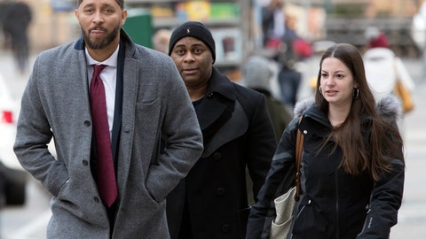 <p>               Former Southern California assistant basketball coach Tony Bland, left, arrives at federal court in New York, Wednesday, Jan. 2, 2019. Bland is expected to plead guilty in a criminal case in which prosecutors said bribes were paid to steer top athletes to certain schools. (AP Photo/Mary Altaffer)             </p>