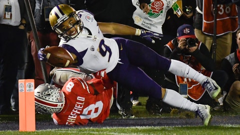 <p>               Washington running back Myles Gaskin, top, scores past Ohio State cornerback Kendall Sheffield during the second half of the Rose Bowl NCAA college football game Tuesday, Jan. 1, 2019, in Pasadena, Calif. Ohio State won 28-23. (AP Photo/Mark J. Terrill)             </p>