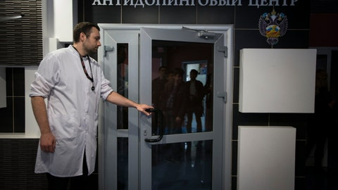 """<p>               FILE - In this Tuesday, May 24, 2016 file photo, Grigory Dudko opens a door for journalists during a visit to Russia's national drug-testing laboratory in Moscow, Russia. Vladimir Putin's spokesman says Russia is """"optimistic"""" ahead of a World Anti-Doping Agency ruling Tuesday Jan. 22, 2019, on whether the country's authorities met demands to turn over lab data. The WADA executive committee reinstated Russia's anti-doping agency in September 2018 on condition the country turned over data from a Moscow laboratory. (AP Photo/Alexander Zemlianichenko, File)             </p>"""
