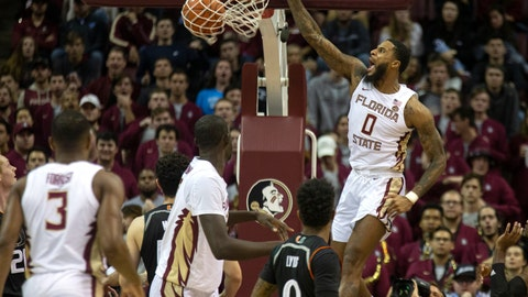 <p>               Florida State forward Phil Cofer turns a rebound into a dunk in the first half of an NCAA college basketball game against Miami in Tallahassee, Fla., Wednesday, Jan. 9, 2019. (AP Photo/Mark Wallheiser)             </p>