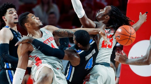 <p>               Houston forward Breaon Brady (24) blocks a shot by Memphis guard Raynere Thornton (4) as he tries to go to the basket between Brady and Houston forward Cedrick Alley Jr. (23) during the first half of an NCAA college basketball game Sunday, Jan. 6, 2019, in Houston. (Brett Coomer/Houston Chronicle via AP)             </p>