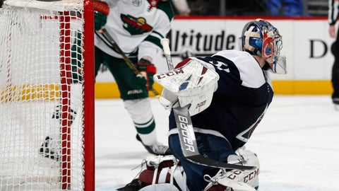 <p>               Colorado Avalanche goaltender Philipp Grubauer, front, allows a shot off the stick of Minnesota Wild center Eric Staal to go into the net for a tally in the second period of an NHL hockey game, Wednesday, Jan. 23, 2019, in Denver. (AP Photo/David Zalubowski)             </p>