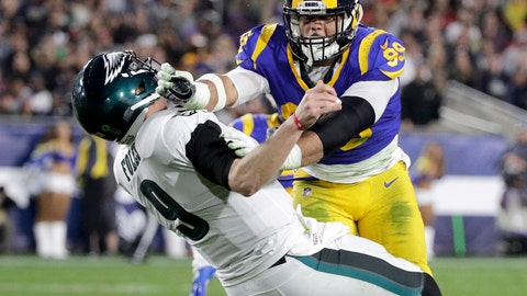 <p>               FILE - In this Dec. 16, 2018, file photo, Los Angeles Rams defensive end Aaron Donald hits Philadelphia Eagles quarterback Nick Foles after Foles threw the ball away during the first half in an NFL football game in Los Angeles. The Rams know they've got to pressure Tom Brady early and often to have a chance in the Super Bowl, and they've been assembling the tools for this job all year long. They signed Ndamukong Suh to a big free-agent deal, wrote a record-breaking contract for Aaron Donald and acquired edge rusher Dante Fowler from Jacksonville down the stretch. (AP Photo/Jae C. Hong, File)             </p>