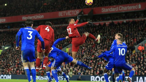 <p>               Liverpool defender Joel Matip, center, heads the ball during the English Premier League soccer match between Liverpool and Leicester City, at Anfield Stadium, Liverpool, England, Wednesday, Jan.29, 2019. (AP Photo/Jon Super)             </p>