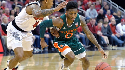 <p>               Miami guard Chris Lykes (0) attempts to drive past the defense of Louisville guard Khwan Fore (4) during the first half of an NCAA college basketball game in Louisville, Ky., Sunday, Jan. 6, 2019. (AP Photo/Timothy D. Easley)             </p>