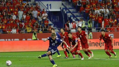 <p>               Japan's midfielder Ritsu Doan scores the penalty kick for the opening goal during the AFC Asian Cup quarterfinal soccer match between Japan and Vietnam at Al Maktoum Stadium in Dubai, United Arab Emirates, Thursday, Jan. 24, 2019. (AP Photo/Hassan Ammar)             </p>