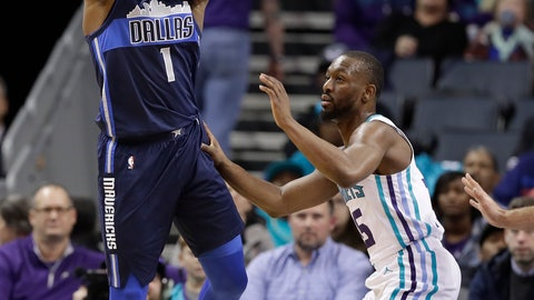 <p>               Dallas Mavericks' Dennis Smith Jr. (1) looks to pass the ball as Charlotte Hornets' Kemba Walker (15) defends during the first half of an NBA basketball game in Charlotte, N.C., Wednesday, Jan. 2, 2019. (AP Photo/Chuck Burton)             </p>