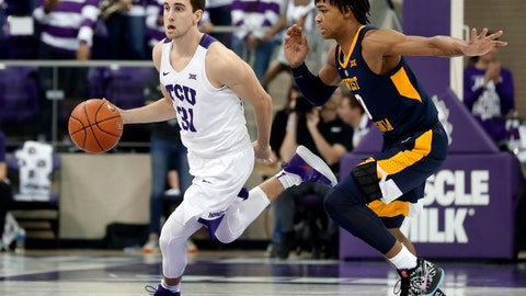 """<p>               In this Jan. 15, 2019, photo, TCU guard Owen Aschieris (31) moves the ball up court as West Virginia's Trey Doomes (0) defends during an NCAA college basketball game in Fort Worth, Texas. TCU walk-on player Aschieris was sitting in a team meeting when a university police officer walked in and asked to speak to him. """"I was racking my brain to think about what I might have done wrong in the past of my entire life,"""" Aschieris said. """"It was crazy."""" (AP Photo/Tony Gutierrez)             </p>"""