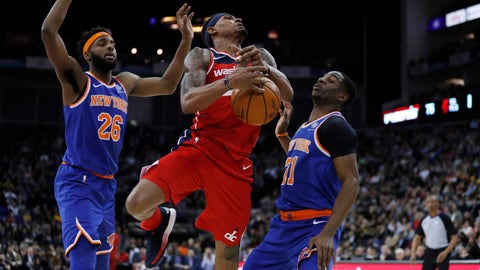 <p>               Washington Wizards guard Bradley Beal (3), is drives to the basket flanked by New York Knicks center Mitchell Robinson (26), left, and his teammate guard Damyean Dotson (21), during an NBA basketball game between New York Knicks and Washington Wizards at the O2 Arena, in London, Thursday, Jan.17, 2019. (AP Photo/Alastair Grant)             </p>