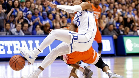 <p>               Duke's Tre Jones (3) collides with Syracuse's Frank Howard during the first half of an NCAA college basketball game in Durham, N.C., Monday, Jan. 14, 2019. Jones was injured on the play and left the court. (AP Photo/Gerry Broome)             </p>