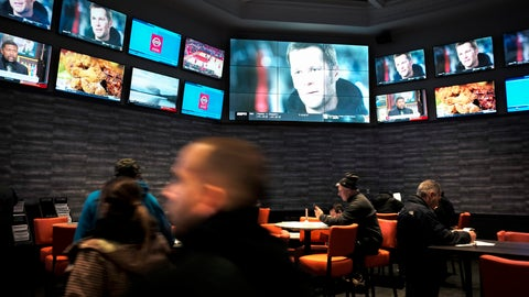 <p>               In this Monday, Jan. 28, 2019 photo, patrons visit the sports betting area of Twin River Casino in Lincoln, R.I. New England Patriots fans are gearing up for Super Bowl 53 by betting on the team to win over the Los Angeles Rams, the first time they can do so legally in New England. Rhode Island is the only state in the region that has launched sports betting so far. (AP Photo/Steven Senne)             </p>