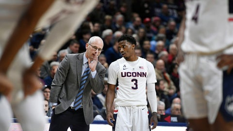 <p>               Connecticut head coach Dan Hurley, back left, talks with Alterique Gilbert (3) during the first half of an NCAA college basketball game against SMU, Thursday, Jan. 10, 2019, in Storrs, Conn. (AP Photo/Jessica Hill)             </p>