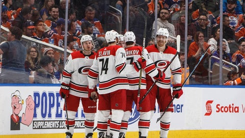 <p>               Carolina Hurricanes players celebrate a goal against the Edmonton Oilers during the second period of an NHL hockey game in Edmonton, Alberta, Sunday, Jan. 20, 2019. (Jason Franson/The Canadian Press via AP)             </p>