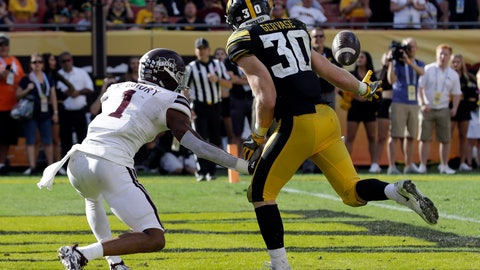 <p>               Iowa defensive back Jake Gervase (30) reaches out to intercept a pass intended for Mississippi State wide receiver Stephen Guidry (1) during the second half of the Outback Bowl NCAA college football game Tuesday, Jan. 1, 2019, in Tampa, Fla. (AP Photo/Chris O'Meara)             </p>