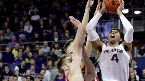 <p>               Washington guard Matisse Thybulle (4) shoots against Washington State forwards Jeff Pollard, left, and Aljaz Kunc, second from left, during the first half of an NCAA college basketball game, Saturday, Jan. 5, 2019, in Seattle. (AP Photo/Ted S. Warren)             </p>