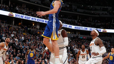 <p>               Golden State Warriors guard Klay Thompson, front, goes up for a basket past Denver Nuggets forward Paul Millsap in the first half of an NBA basketball game, Tuesday, Jan. 15, 2019, in Denver. (AP Photo/David Zalubowski)             </p>