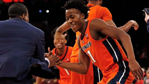 <p>               Illinois guard Ayo Dosunmu (11) celebrates with a coach after defeating No. 13 Maryland 78-67 in an NCAA college basketball game Saturday, Jan. 26, 2019, in New York. Illinois defeated Maryland 78-67. (AP Photo/Adam Hunger)             </p>