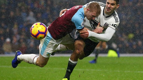 <p>               Fulham's Aleksandar Mitrovic, right, pulls back on Burnley's Ben Mee during the English Premier League soccer match between Burnley and Fulham at the Turf Moor stadium, Burnley, England. Saturday, Jan. 12, 2019. (Dave Thompson/PA via AP)             </p>