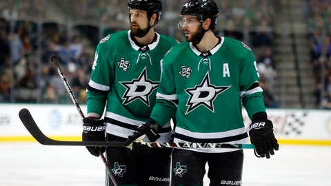 """<p>               FILE - In this Friday, Dec. 29, 2017 file photo, Dallas Stars left wing Jamie Benn (14) and center Tyler Seguin (91) look over the St. Louis Blues defense during the first period of an NHL hockey game in Dallas. First-year Dallas Stars coach Jim Montgomery called out the franchise for a """"culture of mediocrity,"""" led a feedback-sharing session with players and briefly benched one of his top-scoring forwards. And this was all in less than a week, not long after team CEO Jim Lites profanely ripped the performances of captain Jamie Benn and fellow high-priced forward Tyler Seguin.  (AP Photo/Michael Ainsworth, File)             </p>"""