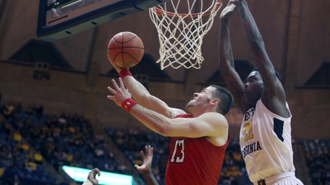 <p>               Texas Tech guard Matt Mooney (13) drives to the basket while defended by West Virginia forward Wesley Harris (21) during the first half of an NCAA college basketball game Wednesday, Jan. 2, 2019, in Morgantown, W.Va. (AP Photo/Raymond Thompson)             </p>