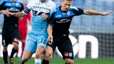 <p>               Lazio's Joaquin Correa, left, and Novara's Ronaldo vie for the ball during the Italian Cup soccer match between Lazio and Novara at the Olympic stadium in Rome, Saturday, Jan. 12, 2019. (Claudio Peri/ANSA via AP)             </p>