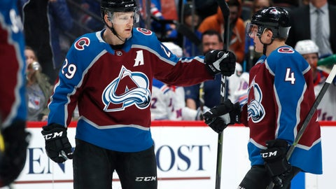 <p>               Colorado Avalanche center Nathan MacKinnon, left, is congratulated after scoring a goal by defenseman Tyson Barrie in the first period of an NHL hockey game against the New York Rangers Friday, Jan. 4, 2019, in Denver. (AP Photo/David Zalubowski)             </p>
