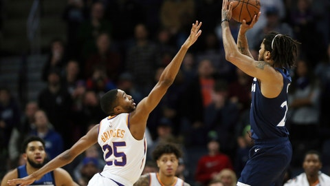 <p>               Minnesota Timberwolves' Derrick Rose shoots the game-winning shot over Phoenix Suns' Mikal Bridges in the first half of an NBA basketball game Sunday, Jan. 20, 2019, in Minneapolis. Minnesota won 116-114. (AP Photo/Stacy Bengs)             </p>