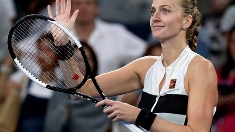 <p>               Petra Kvitova of the Czech Republic celebrates after defeating Switzerland's Belinda Bencic during their third round match at the Australian Open tennis championships in Melbourne, Australia, Friday, Jan. 18, 2019. (AP Photo/Aaron Favila)             </p>