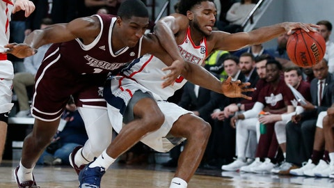 <p>               Mississippi guard Blake Hinson, right, recovers a loose ball as Mississippi State forward Reggie Perry, left, falls in the first half of an NCAA college basketball game, Saturday, Jan. 12, 2019 in Starkville, Miss. (AP Photo/Rogelio V. Solis)             </p>
