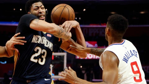 <p>               New Orleans Pelicans' Anthony Davis, left, gets fouled by Los Angeles Clippers' Tyrone Wallace during the second half of an NBA basketball game, Monday, Jan. 14, 2019, in Los Angeles. The Pelicans won 121-117. (AP Photo/Ringo H.W. Chiu)             </p>