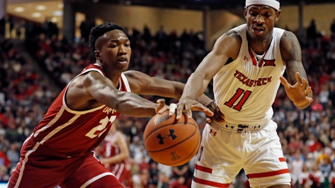 <p>               Oklahoma's Kristian Doolittle (21) and Texas Tech's Tariq Owens (11) reach out for the ball during the first half of an NCAA college basketball game Tuesday, Jan. 8, 2019, in Lubbock, Texas. (AP Photo/Brad Tollefson)             </p>