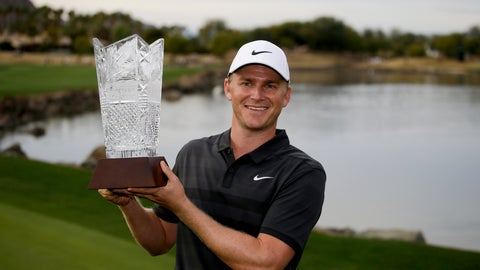 <p>               Adam Long holds the trophy on the 18th green after winning the Desert Classic golf tournament on the Stadium Course at PGA West on Sunday, Jan. 20, 2019, in La Quinta, Calif. (AP Photo/Chris Carlson)             </p>