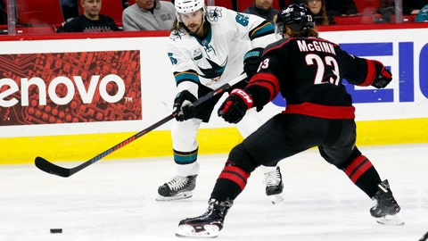 <p>               File-This Oct. 26, 2018, file photo shows San Jose Sharks' Erik Karlsson (65) of Sweden passing around Carolina Hurricanes' Brock McGinn (23), who lost his stick, during the second period of an NHL hockey game in Raleigh, N.C. There is still a chance  Karlsson takes part in NHL All-Star Weekend despite missing the final three games before the break with an injury. Sharks coach Peter DeBoer says Karlsson went back to California for more tests on what the team is calling a lower-body injury. Karlsson missed the past two games and is out for San Jose's game Wednesday, Jan. 23, 2019,  at the defending Stanley Cup champion Capitals.  (AP Photo/Chris Seward, File)             </p>