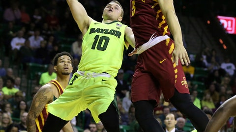 <p>               Baylor guard Makai Mason, left, shoots over Iowa State guard Lindell Wigginton during the second half of an NCAA college basketball game Tuesday, Jan. 8, 2019, in Waco, Texas. Baylor won 73-70. (AP Photo/Rod Aydelotte)             </p>