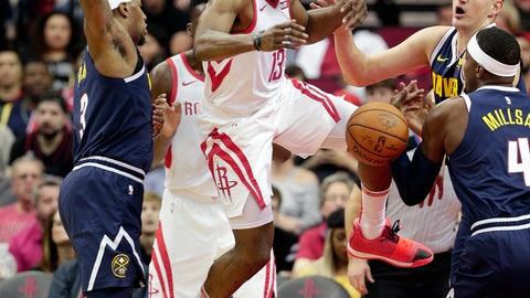 <p>               Houston Rockets guard James Harden (13) loses the ball on a shot-attempt between Denver Nuggets forward Torrey Craig (3), center Nikola Jokic (15) and forward Paul Millsap (4) during the first half of an NBA basketball game Monday, Jan. 7, 2019, in Houston. (AP Photo/Michael Wyke)             </p>