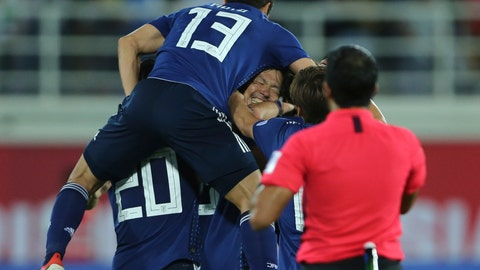 <p>               Japan players celebrate after Japan's Tsukasa Shiotani, centre, scored his side's second goal during the AFC Asian Cup group F soccer match between Japan and Uzbekistan at Khalifa bin Zayed Stadium in Al Ain, United Arab Emirates, Thursday, Jan. 17, 2019. (AP Photo/Kamran Jebreili)             </p>