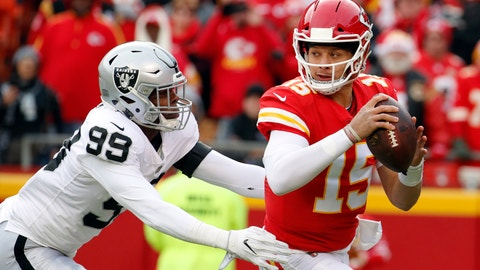 <p>               FILE - In this Sunday, Dec. 30, 2018 file photo, Kansas City Chiefs quarterback Patrick Mahomes (15) breaks a tackle-attempt by Oakland Raiders defensive end Arden Key (99) during the first half of an NFL football game in Kansas City, Mo.. For the first time in a decade, the top seed in the AFC playoffs goes to a team not led by Tom Brady or Peyton Manning. The Chiefs haven't had a true franchise QB since Len Dawson led the Chiefs to their only Super Bowl title. But after trading up to select Mahomes in the first round in 2017, then letting him learn the ropes under Alex Smith, Mahomes responded with one of the best seasons in NFL history for a first-year starter. (AP Photo/Charlie Riedel, File)             </p>
