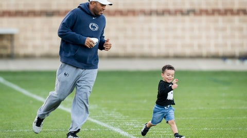 <p>               FILE - In this Sept. 27, 2017, file photo, then-Penn State wide receivers coach Josh Gattis chases his son Jace, 2, following NCAA college football practice, in State College, Pa. Michigan hired Josh Gattis away from Alabama to be Jim Harbaugh's offensive coordinator on Thursday, Jan. 19, 2019. The 34-year-old Gattis was a co-offensive coordinator last season for the Crimson Tide. Gattis was Penn State's wide receivers coach and passing-game coordinator and led the program's offensive recruiting efforts the previous four seasons. (Joe Hermitt/PennLive.com via AP, File)             </p>
