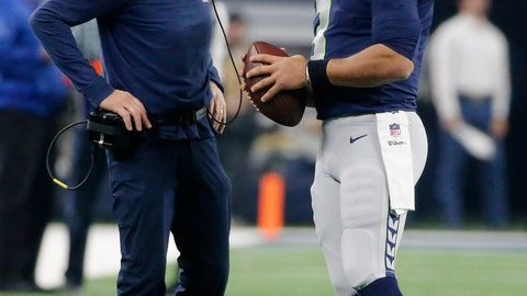 <p>               Seattle Seahawks head coach Pete Carroll speaks with quarterback Russell Wilson during the first half of the NFC wild-card NFL football game against the Dallas Cowboys, in Arlington, Texas, Saturday, Jan. 5, 2019. (AP Photo/Michael Ainsworth)             </p>