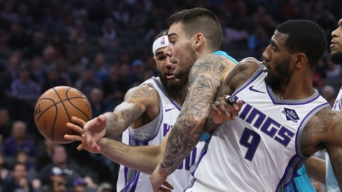 <p>               Charlotte Hornets center Willy Hernangomez, center, battles Sacramento Kings' Willie Cauley-Stein, left, and Iman Shumpert for the ball during the first quarter of an NBA basketball game Saturday, Jan. 12, 2019, in Sacramento, Calif. (AP Photo/Rich Pedroncelli)             </p>