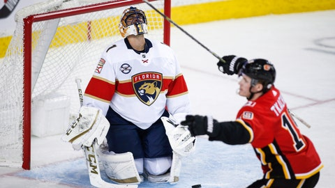 <p>               Florida Panthers goalie Roberto Luongo, left, reacts as Calgary Flames' Matthew Tkachuk celebrates his goal during third-period NHL hockey game action in Calgary, Alberta, Friday, Jan. 11, 2019. (Jeff McIntosh/The Canadian Press via AP)             </p>