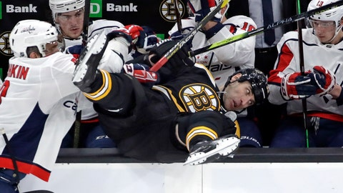 <p>               Boston Bruins defenseman Zdeno Chara is checked into the Washington Capitals bench by Washington Capitals left wing Alex Ovechkin, left, during the first period of an NHL hockey game Thursday, Jan. 10, 2019, in Boston. (AP Photo/Elise Amendola)             </p>