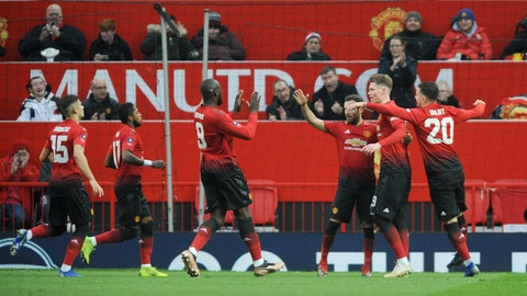 <p>               Manchester United's players celebrate after scoring the opening goal during the English FA Cup third round soccer match between Manchester United and Reading at Old Trafford in Manchester, England, Saturday, Jan. 5, 2019. (AP Photo/Rui Vieira)             </p>